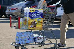 Almost every cart had toilet paper in it as customers leave BJ's Wholesale Club on Wednesday, March 18, 2020 in Colonie, N.Y. (Lori Van Buren/Times Union) ORG XMIT: ALB2003181137360045