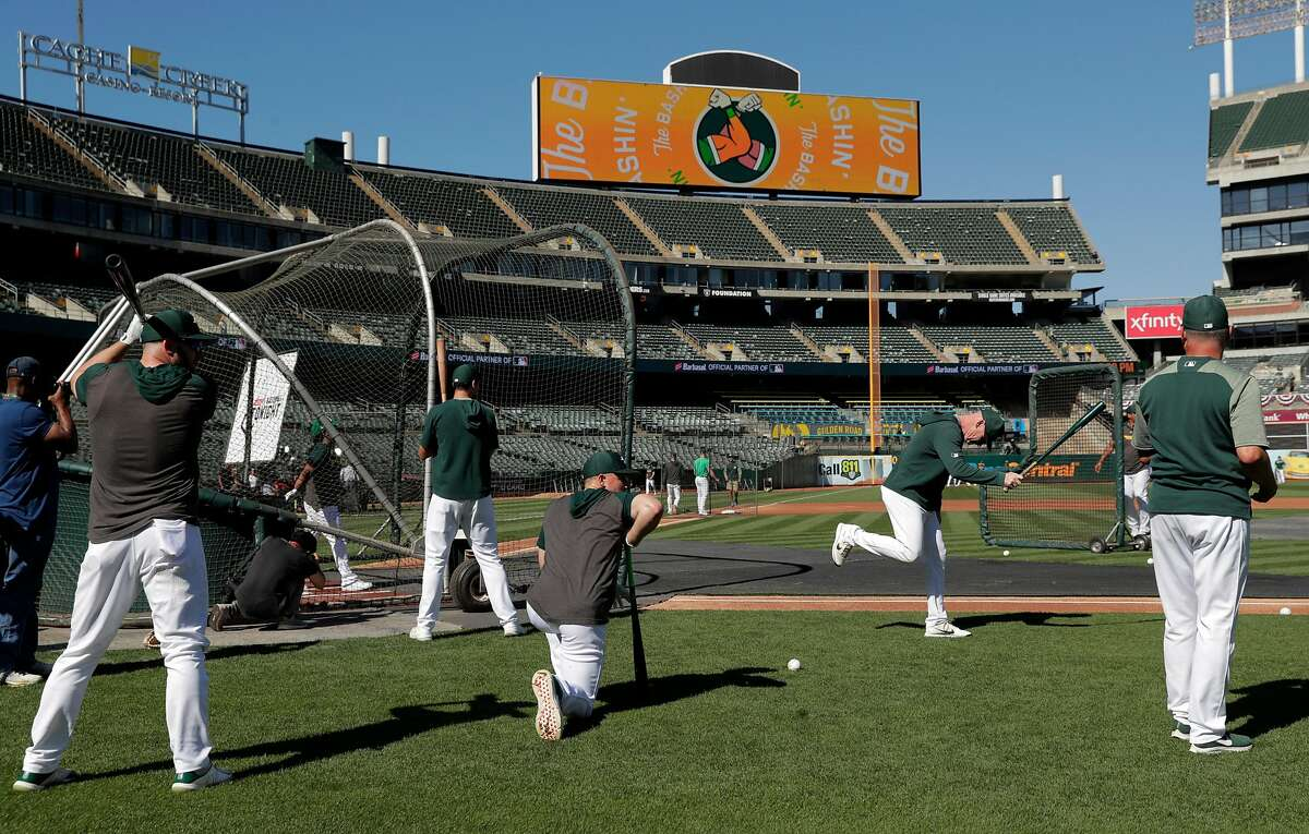 Oakland A's players warm up before the Oakland Athletics played the Tampa Bay Rays at the Oakland Coliseum in the Wild Card playoff game in Oakland, Calif., on Wednesday, October 2, 2019.
