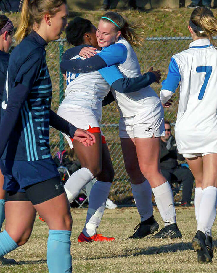 Lewis and Clark's Boitumelo Rabale, left, hugs teammate Candice Parziani after a goal by Rabale in last season's Central District championship game against St. Louis Community College at Meramec College in Kirkwood, Mo. LCCC won 6-1. Rabale, a sophomore, later earned NJCAA National Player of the Year honors and will play at Cape Breton University in Nova Scotia this fall. Parziani plans to return next fall for LCCC. Photo: Pete Hayes | The Telegraph