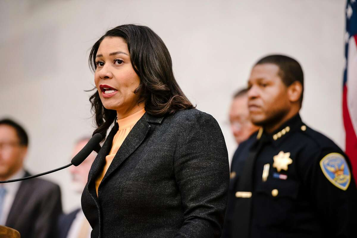 San Francisco Police Department Chief of Police Bill Scott, right, listens as Mayor London Breed, left, during a press conference on Monday, March 16, 2020. In the wake of the Atlanta killing of six Asian women and recent Bay Area violence against Asian Americans, Breed has directed the San Francisco Police Department to immediately increase patrols in areas with high numbers of Asian residents, visitors and businesses.