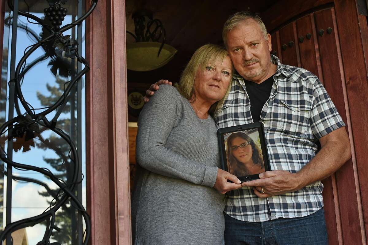 Liz and Mark Todd, at their home in Sonoma, Calif., hold a picture of their daughter Brittany Stewart Todd, 28, that she texted to them yesterday afternoon while she was in Nicaragua to show that she was doing OK after struggling to get a flight back to California due to COVID-19 travel restrictions on Thursday, March 19, 2020. Brittany had been in Cancun, Mexico for a bachelorette party last week then had to journey through four different countries in order to make her way back to her home in Petaluma, California today.