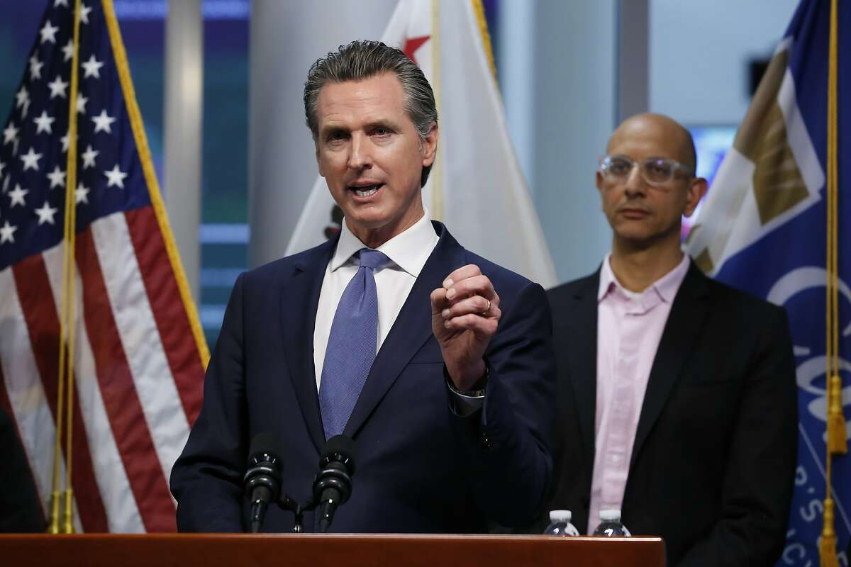 FILE - In this March 17, 2020 file photo, California Gov. Gavin Newsom gives an update to the state's response to the coronavirus at the Governor's Office of Emergency Services in Rancho Cordova Calif.