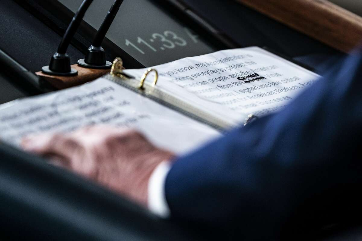 """A close up of President Donald J. Trump's notes shows where Corona was crossed out """"Corona"""" and replaced with """"Chinese"""" Virus as he speaks with his coronavirus task force in response to the COVID-19 coronavirus pandemic during a briefing in the James S. Brady Press Briefing Room at the White House on Thursday, March 19, 2020 in Washington, DC."""