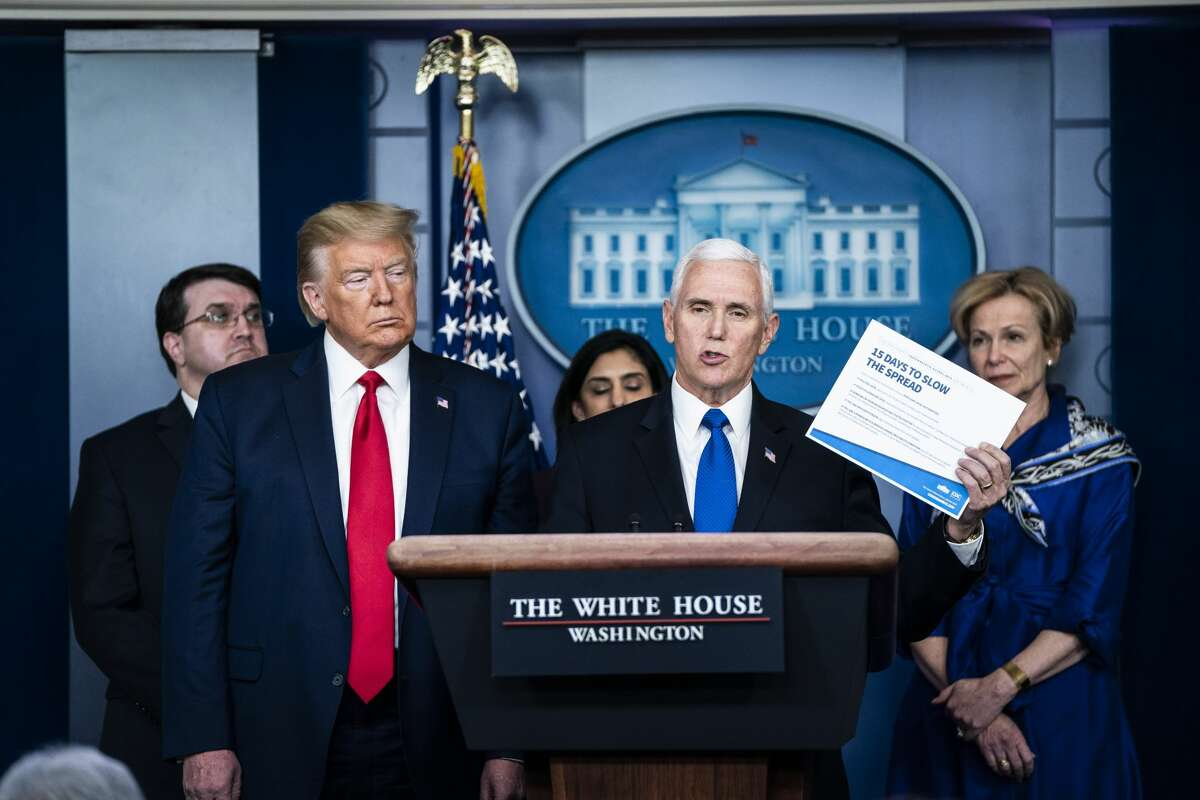 Vice President Mike Pence and President Donald J. Trump speak with his coronavirus task force in response to the COVID-19 coronavirus pandemic during a briefing in the James S. Brady Press Briefing Room at the White House on Wednesday, March 18, 2020 in Washington, DC.