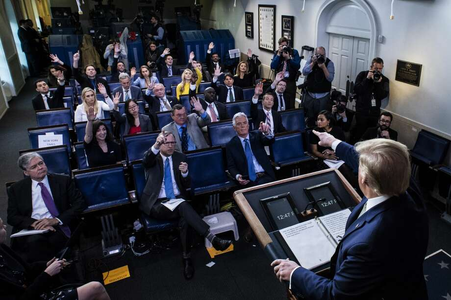 President Donald Trump speaks with his coronavirus task force in response to the COVID-19 coronavirus pandemic during a briefing March 17, 2020 in Washington, DC. Photo: The Washington Post/The Washington Post Via Getty Im / 2020 The Washington Post