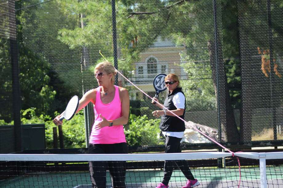 Wilton resident Amy Shay (foreground) and her partner Cynthia Dardis of Stamford are among the country's top-ranked women's doubles teams in platform tennis. Photo: Contributed Photo / Calderwood Digital