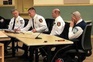 Torrington Fire Chief Peter Towey, second from left, is also the city's emergency management director. This week, he asked residents to continue to support each other during the coronavirus crisis.