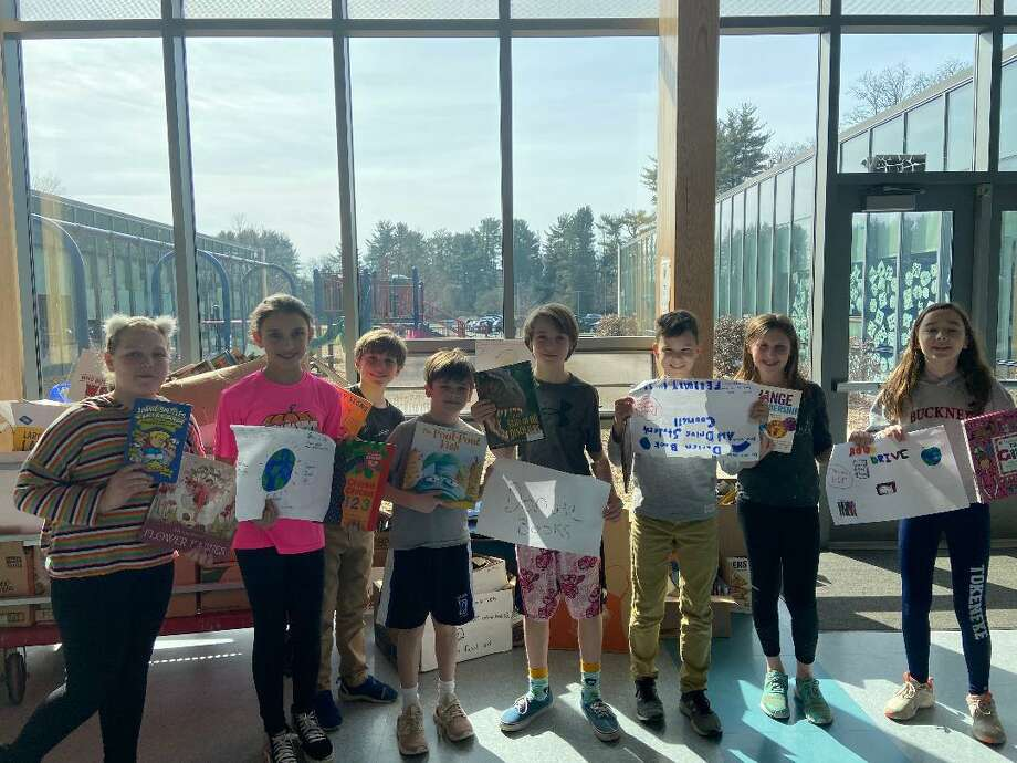 Thanks to the students and families of Tokeneke School, the book drive was a huge success and yielded a record-number 5,836 gently-used books for the non-profit. Photo: Contributed Photo / Connecticut Post