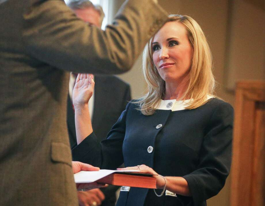 Judge Jennifer Robin, 410th Judicial District Court, is sworn in by Judge Tracy Gilbert during the Montgomery County Ceremony to Administer Oath of Office on Sunday, Jan. 1, 2017, at the Lone Star Convention Center. Photo: Michael Minasi, Staff / Houston Chronicle / © 2017 Houston Chronicle