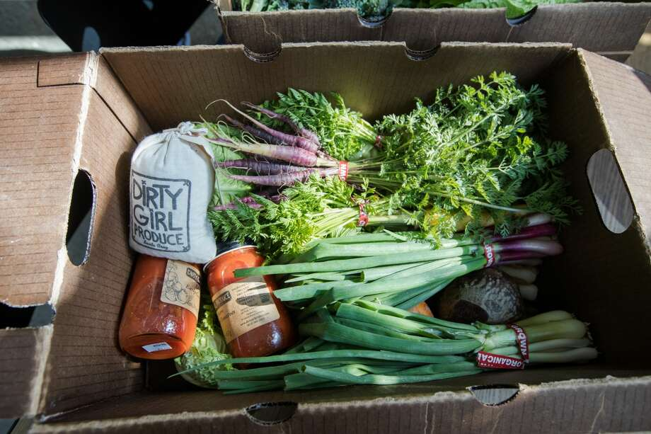 A CSA pre-packed box of fresh organic produce and shelf-stable pantry items from Dirty Girl Produce waiting to be picked up at Nari restaurant in Japantown in San Francisco, California on March 19, 2020. Photo: Douglas Zimmerman/SFGate / SFGate