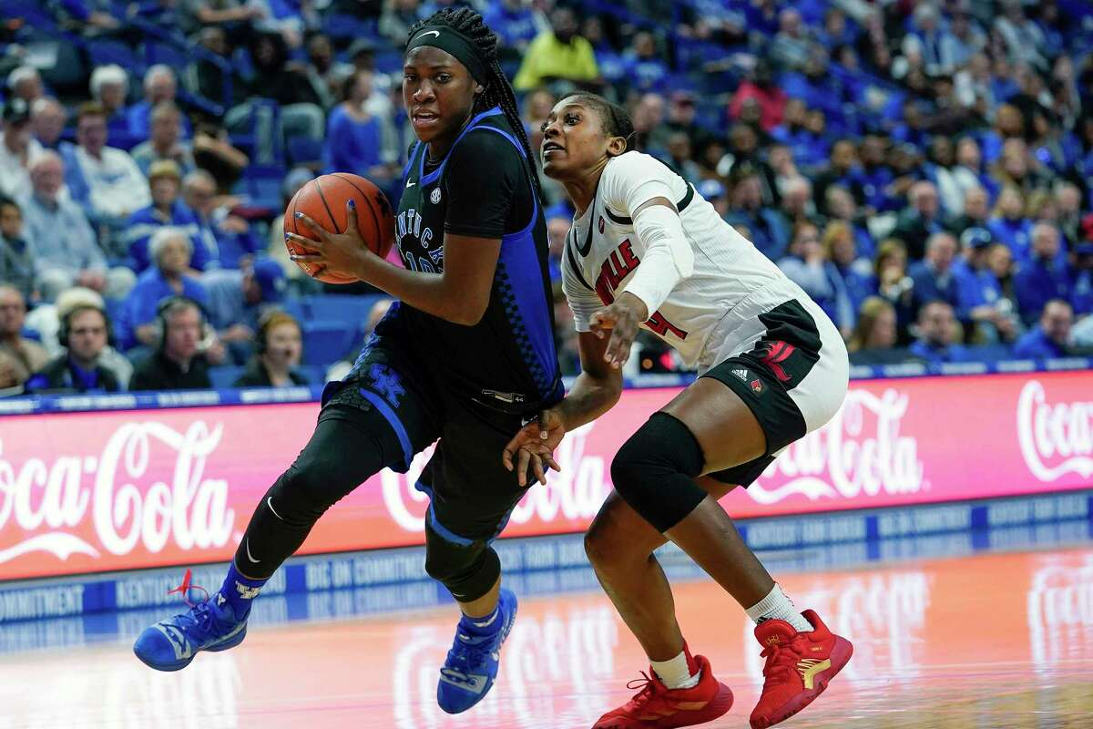 FILE - In this Dec. 15, 2019, file photo, Kentucky guard Rhyne Howard (10) dribbles past Louisville guard Elizabeth Balogun (4) during the first half of an NCAA basketball game in Lexington, Ky. Howard did nearly everything for Kentucky this season. The sophomore guard averaged 23.4 points, 6.5 rebounds and hit 84 3-pointers. Howard was selected to The Associated Press women's All-America first team, Thursday, March 19, 2020. (AP Photo/Bryan Woolston, File)