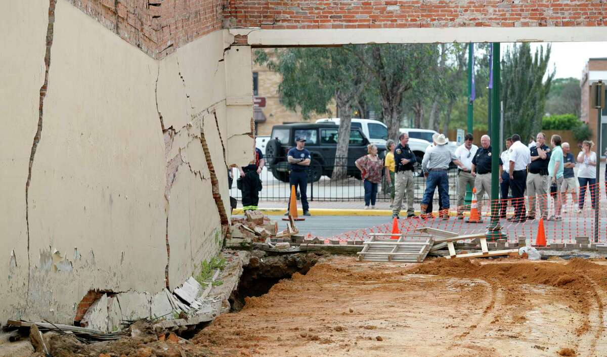 Damage is seen to a shared wall with Branding Iron Productions near the Crighton Theatre, Thursday, March 19, 2020, in Conroe. The space was undergoing renovations to turn the space into additional restrooms for the historic theatre.