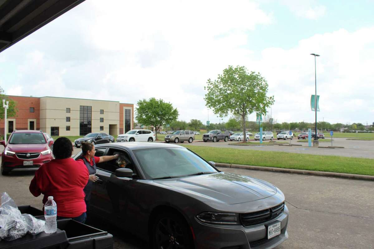 Pasadena ISD's child nutrition services employees hand out meals to families during the COVID-19 crisis-related school closure.