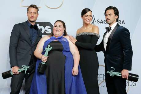 """Justin Hartley, left, Chrissy Metz, Mandy Moore and Milo Ventimiglia, winners of Outstanding Performance by an Ensemble in a Drama Series for """"This Is Us,"""" appear at the 25th annual Screen Actors Guild Awards at The Shrine Auditorium in Los Angeles, Jan. 27, 2019. Photo: Sarah Morris / Getty Images / 2019 Getty Images 2019 Getty Images"""