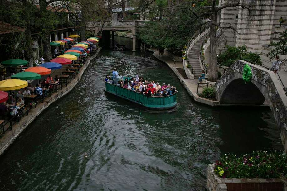 A Go Rio tour barge glides along San Antonio River earlier this week. The city's tourism business has gone into a tailspin. Photo: Josie Norris / Staff Photographer / **MANDATORY CREDIT FOR PHOTOG AND SAN ANTONIO EXPRESS-NEWS/NO SALES/MAGS OUT/TV