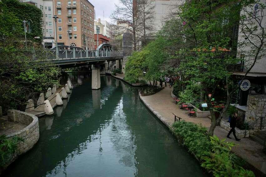 A man walks along the Riverwalk in downtown San Antonio, Texas, on March 16, 2020.