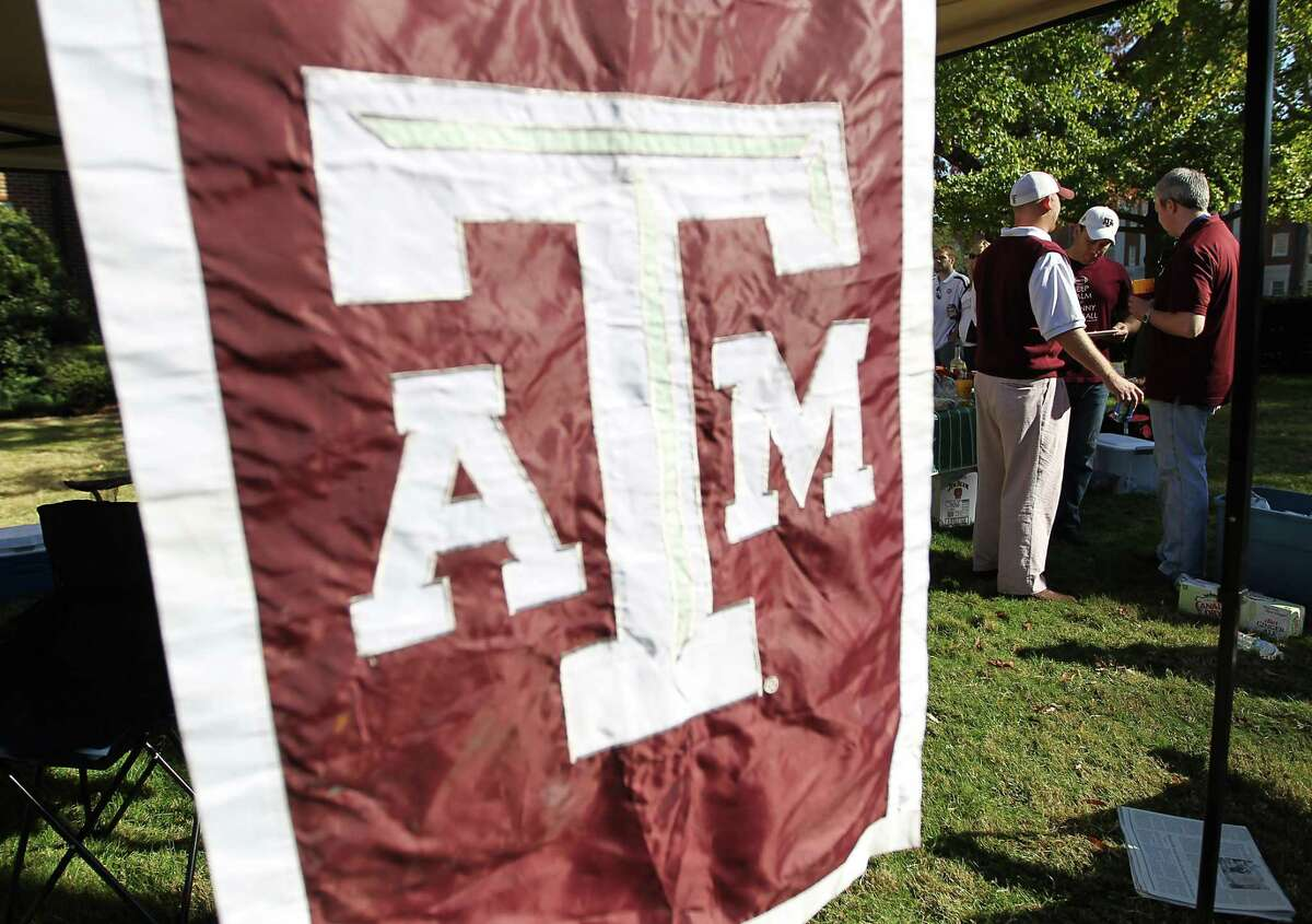 """Texas Aggie alums tailgate on the """"quad"""" before the start of a college football game at Bryant-Denny Stadium, Saturday, Nov. 10, 2012, in Tuscaloosa. ( Karen Warren / Houston Chronicle )"""