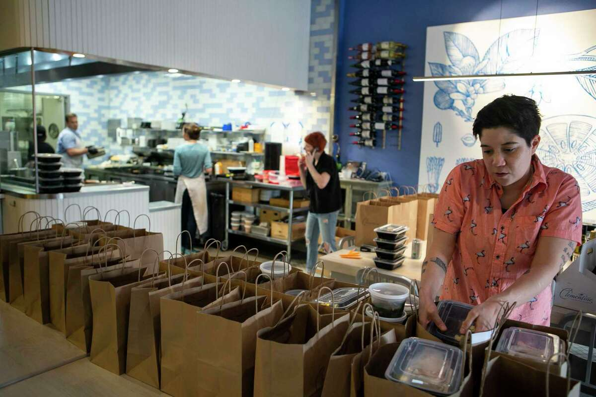 Kayla Webber packs up a takeout order at Clementine.