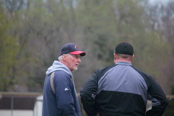 Big Rapids coach Sam Daugherty (left) talks with former Reed City coach Marty Shaffer at a game last season. (Pioneer file photo)