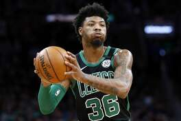Boston Celtics' Marcus Smart plays against against the Oklahoma City Thunder during an NBA basketball game, Sunday, March, 8, 2020, in Boston. (AP Photo/Michael Dwyer)