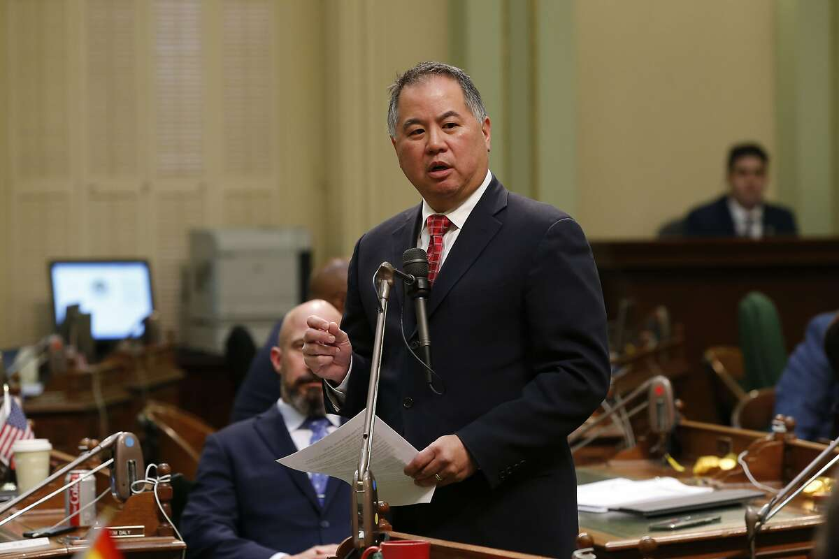 Assemblyman Phil Ting, D-San Francisco, urges lawmakers to approve legislation to provide up to $1 billion in new spending to combat the coronavirus outbreak, at the Capitol in Sacramento, Calif., Monday, March 16, 2020. (AP Photo/Rich Pedroncelli)