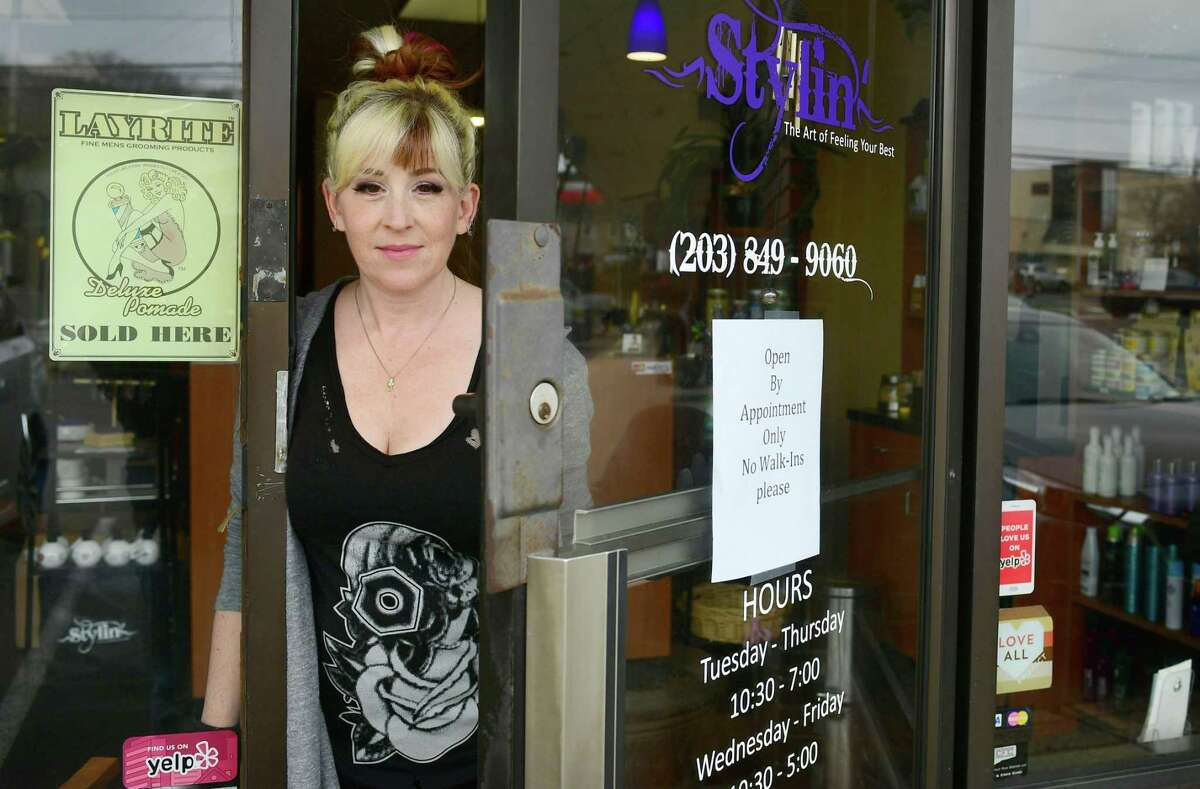 Emilie Forcellina, owner of Stylin' salon, at her salon on Main Ave. Thursday, March 19, 2020, in Norwalk, Conn. Mayor Rilling ordered salons and barbershops in Norwalk close to stop coronavirus spread.