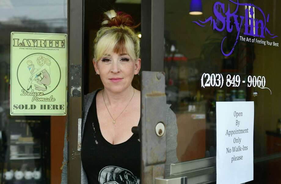 Emilie Forcellina, owner of Stylin' salon on Main Avenue in Norwalk, said she will use the extra time before reopening to stock up on personal protective equipment. Photo: Erik Trautmann / Hearst Connecticut Media / Norwalk Hour