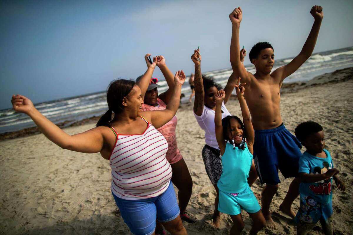 The Morris family from Houston took the day to enjoy the beach on Thursday, March 19, 2020, in Galveston. They said they need it a break from spending time inside the their homes.
