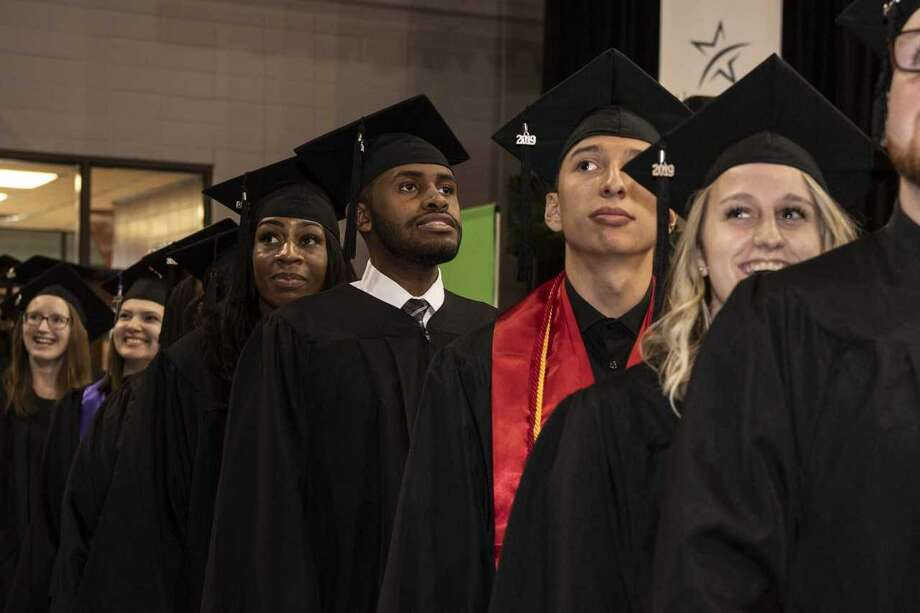 Through all the different campus' graduation ceremonies, more than 8,200 Lone Star College students were awarded with associate degrees and certificates last year. Photo: Submitted Photo / Submitted Photo