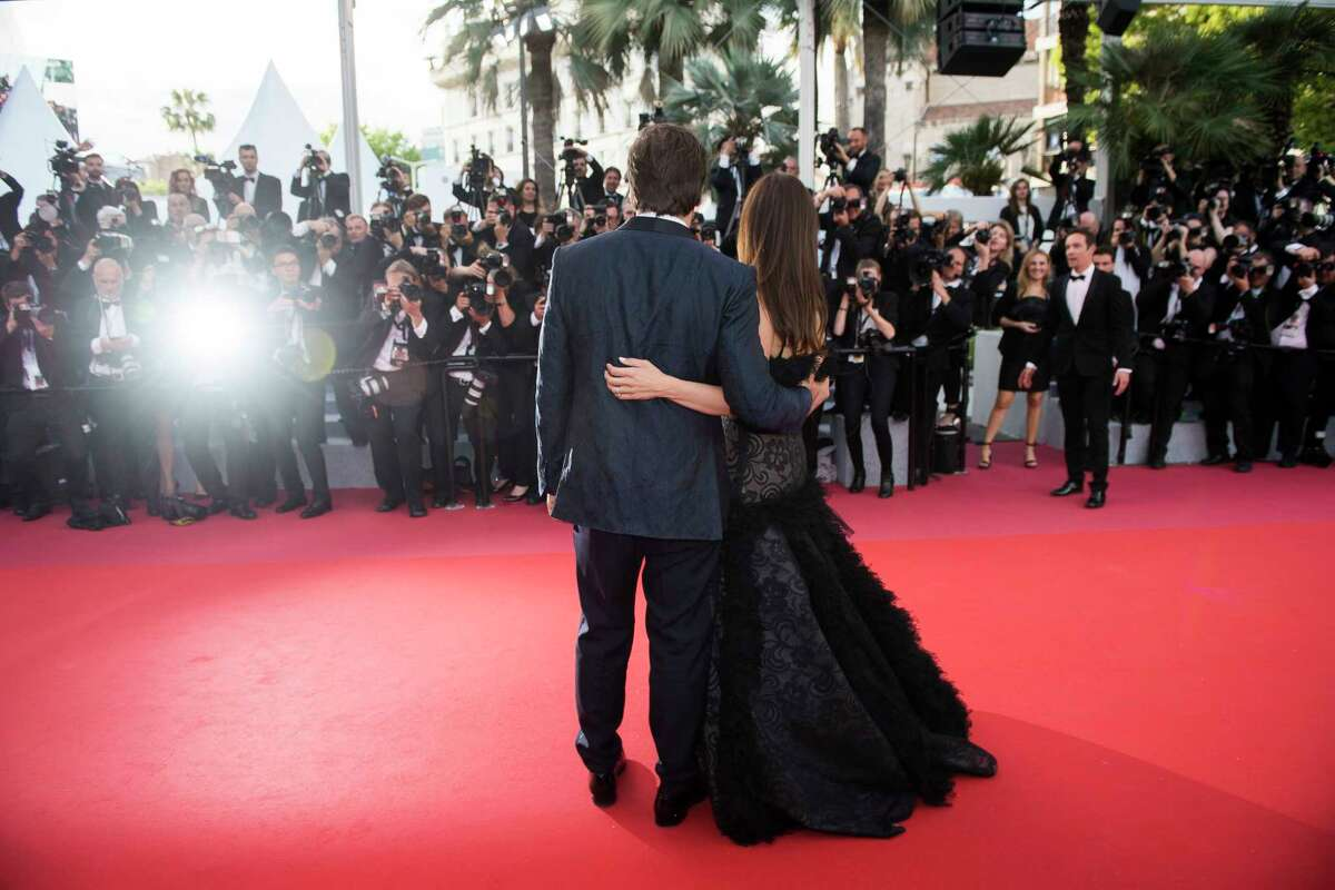 FILE - In this May 8, 2018 file photo, actors Penelope Cruz, right, and Javier Bardem pose for photographers at the opening ceremony of the 71st international film festival, Cannes, southern France. Arguably the worlda€™s most prestigious film festival and cinemaa€™s largest annual gathering has postponed its 73rd edition. Organizers of the French Riviera festival, scheduled to take place May 12-23, said they are considering moving the festival to the end of June or the beginning of July. (Photo by Arthur Mola/Invision/AP, File)