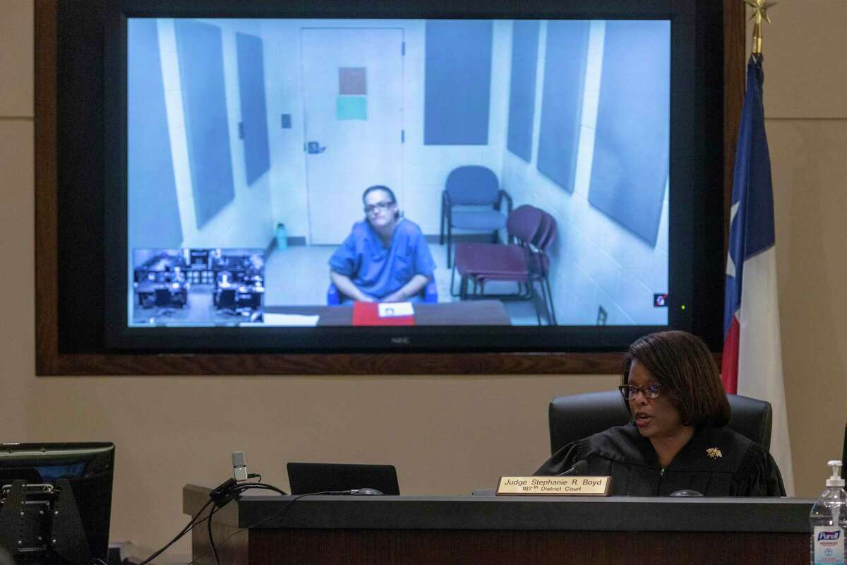 Judge Stephanie Boyd presides over a case Thursday, March 19, 2020, where the defendant appeared via videoconference. The state district courts are trying videoconferencing as a means to keep down the number of people who have to be in the courtroom as the coronavirus outbreak causes concern.