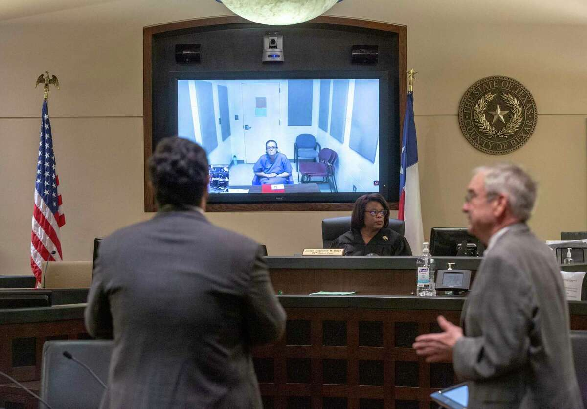 Judge Stephanie Boyd, center, presides over a case using videoconferencing as a way to create social distancing.