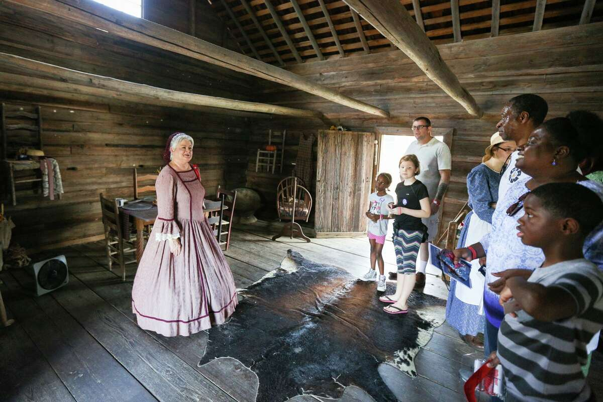 Montgomery resident Eva Rains, the descendent of the original owners of the Crane House in the Fernland Historical Park, Mary Ann Havard and Nickolas Crane, tells the history of the home to attendees of the Texian Heritage Festival on Saturday, Oct. 7 2017, at Fernland Historical Park in Montgomery.