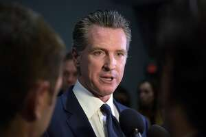 """(FILES) In this file photo California Governor Gavin Newsom speaks to the press in the spin room after the sixth Democratic primary debate of the 2020 presidential campaign season co-hosted by PBS NewsHour & Politico at Loyola Marymount University in Los Angeles, California on December 19, 2019. - California Gov. Gavin Newsom (D) issued a statewide stay-at-home order starting March 19, 2020 evening. This is a moment we need to make tough decisions,"""" Newsom said at an online news conference. It is the strongest statewide restriction yet aimed at stemming the spread of the coronavirus. The announcement follows similar orders issued in the past few days across the San Francisco Bay area and Los Angeles. (Photo by Agustin PAULLIER / AFP) (Photo by AGUSTIN PAULLIER/AFP via Getty Images)"""
