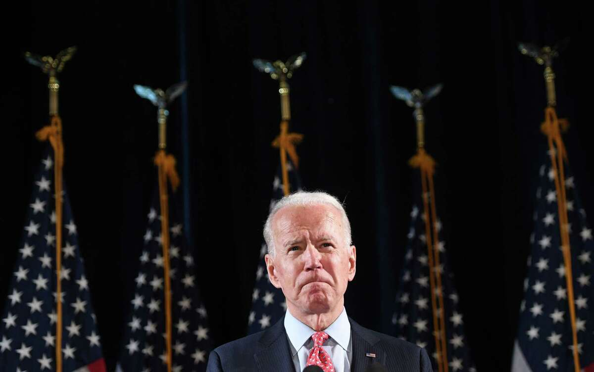 (FILES) In this file photo taken on March 12, 2020 former US Vice President and Democratic presidential hopeful Joe Biden speaks about COVID-19, known as the Coronavirus, during a press event in Wilmington, Delaware. - Biden easily won the Florida primary, today's biggest prize, on March 17, 2020, according to a projection by Edison Media Research, as voting continues in Arizona and Illinois. (Photo by SAUL LOEB / AFP) (Photo by SAUL LOEB/AFP via Getty Images)