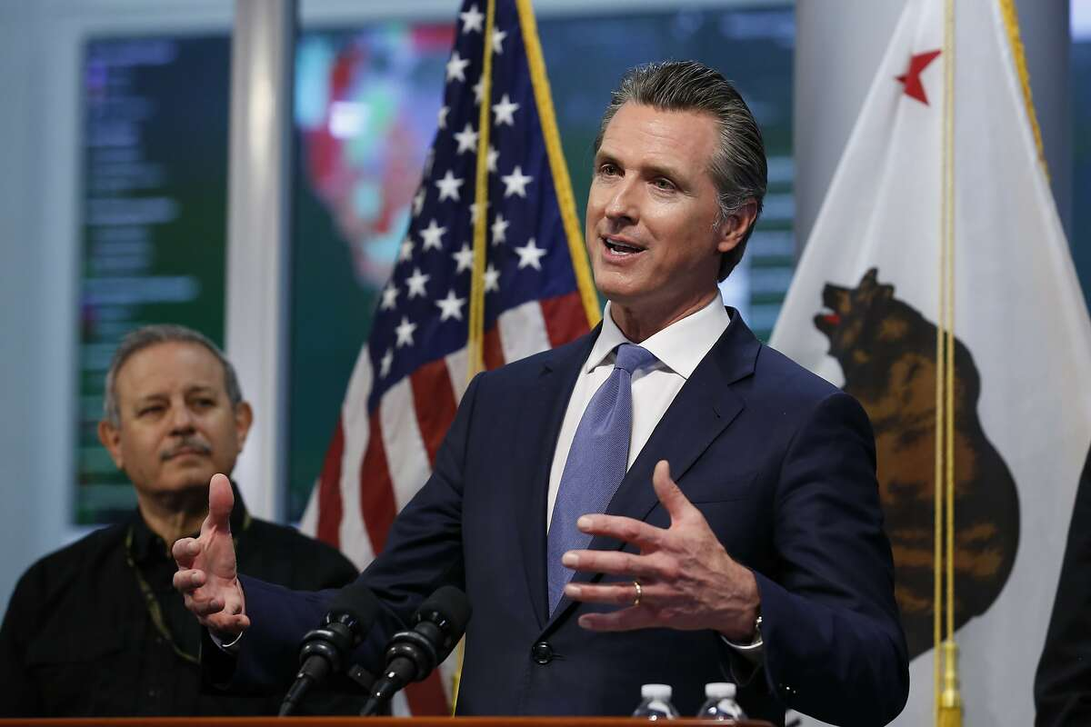 California Gov. Gavin Newsom give an update to the state's response to the coronavirus, at the Governor's Office of Emergency Services in Rancho Cordova Calif., Tuesday, March 17, 2020. At left is Mark Ghilarducci, director of the OES. (AP Photo/Rich Pedroncelli, Pool)