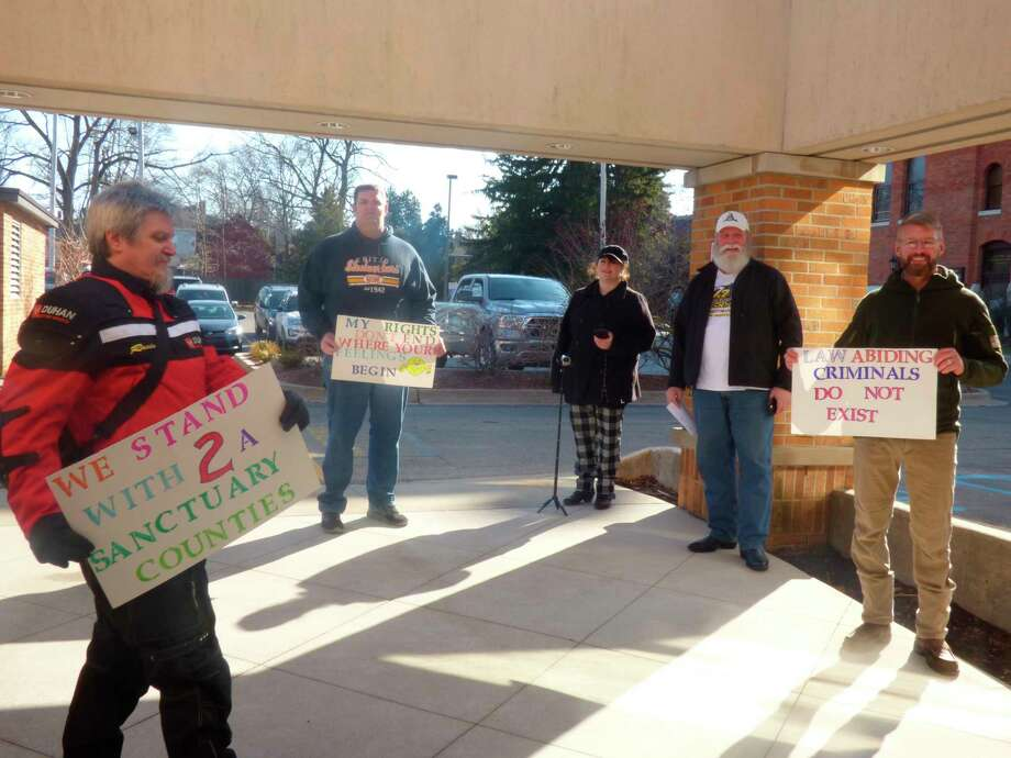 Second amendment activists protest outside the county courthouse on Tuesday. (Scott Fraley/News Advocate)