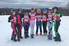 The New Canaan girls skiers, from left, Evie Bradley, Amelie L'Henaff, Natalie Fuhr, Meredith Waldron, Paxton Beladino, Julia Paine, Hannah Smick, and Rory McCarthy at the CISL State Open on March 2 at Mount Southington. Missing from photo is Lisette Jimenez.