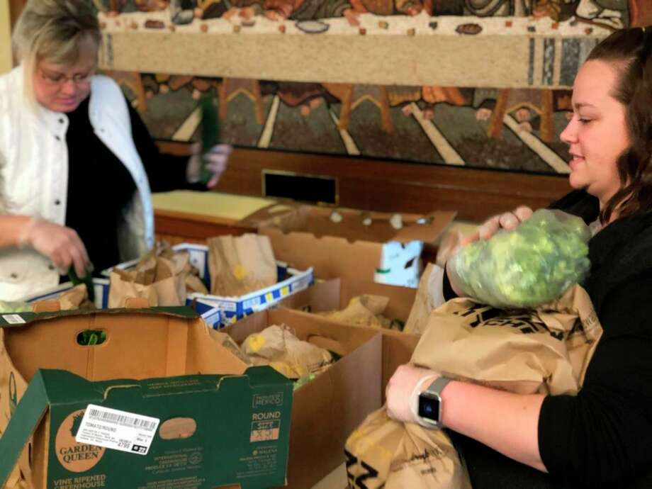The Open Door team worked quickly to process and package the donations of fresh produce. (Photo provided/Open Door)
