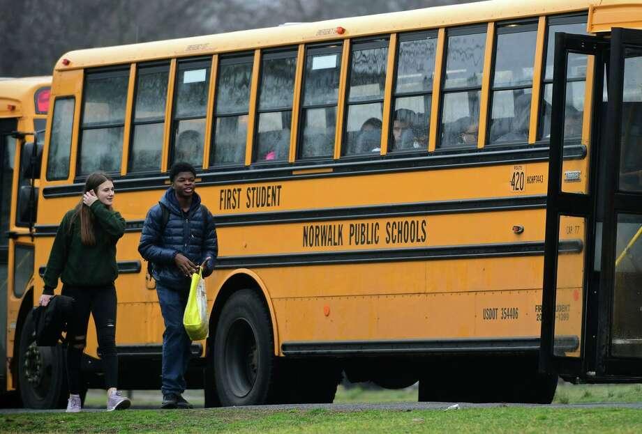 Students exit Norwalk High School after an early dismissal Friday, March 13, 2020, in Norwalk, Conn. Photo: Erik Trautmann / Hearst Connecticut Media / Norwalk Hour