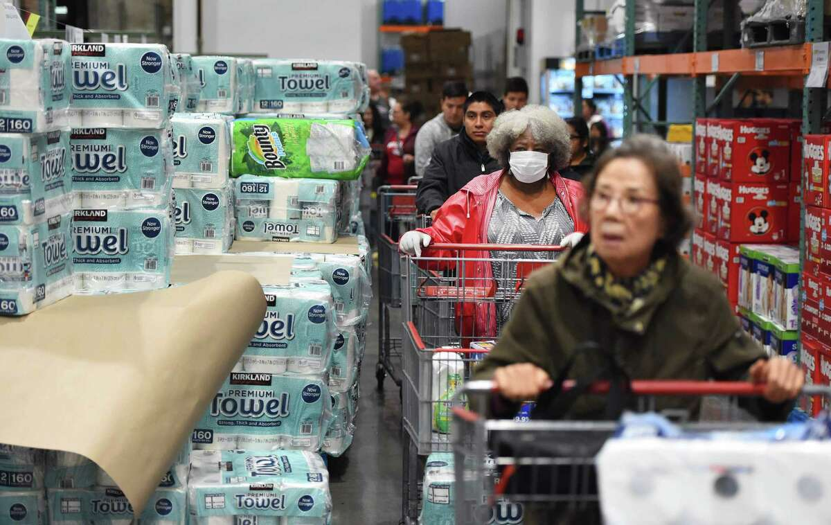 In this file photo a line of shoppers wait to buy toilet paper at a Costco store in Novato, California on March 14, 2020.