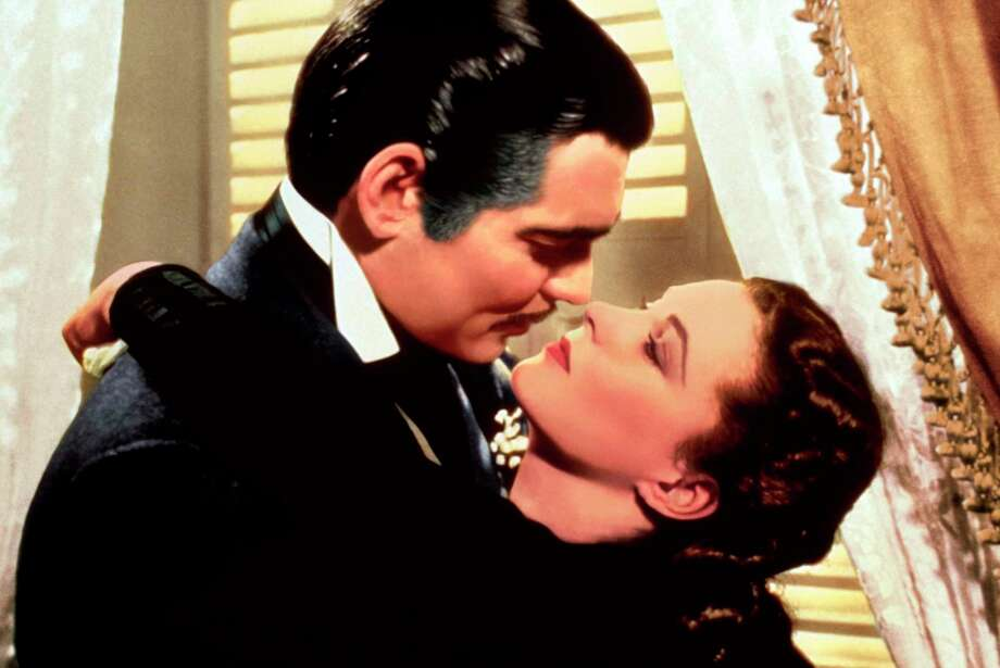 "Clark Gable, left, and Vivien Leigh in a scene from ""Gone with the Wind."" Photo: AP / Copyright (c) 1939 Turner Entertainment Co., A Time Warner Company. All Rights Reserved."