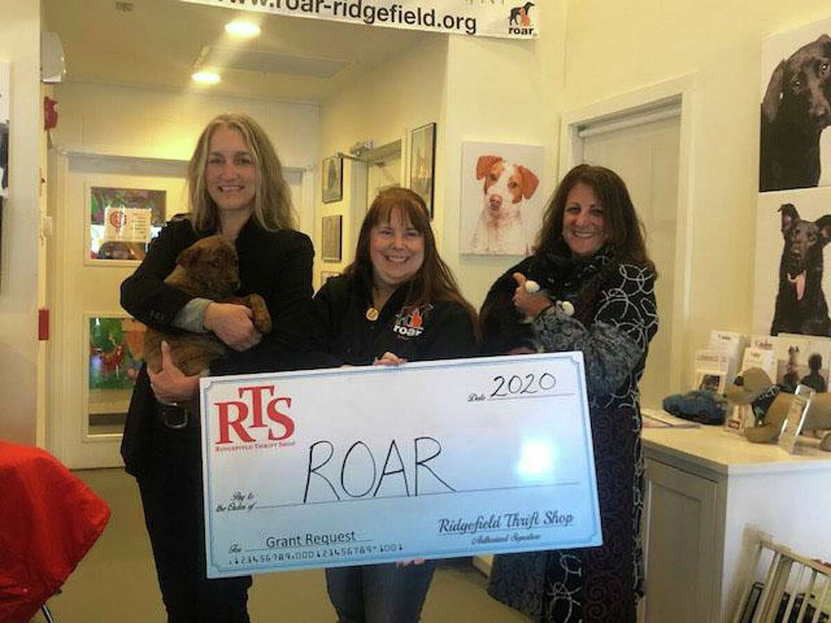 RTS volunteer Pamela Simoneau; Kerry Dobson, ROAR executive director and Sandra Capriotti, RTS president hold a grant check for Ridgefield Operation for Animal Rescue (ROAR).