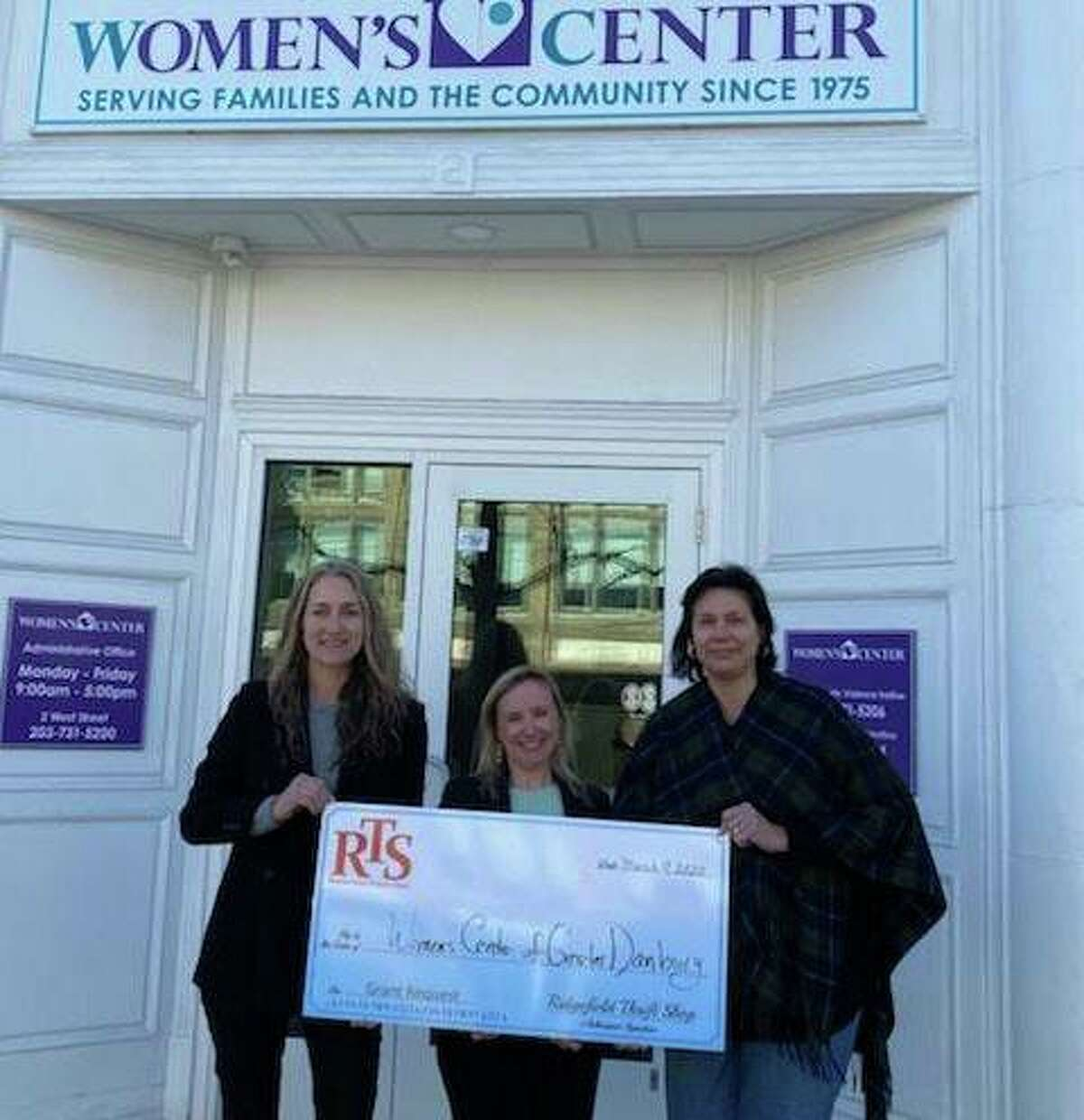 Pamela Simoneau, RTS volunteer; Samantha Flynn, director of development and Patricia Hellman, RTS volunteer hold a check for the Women's Center of Danbury.