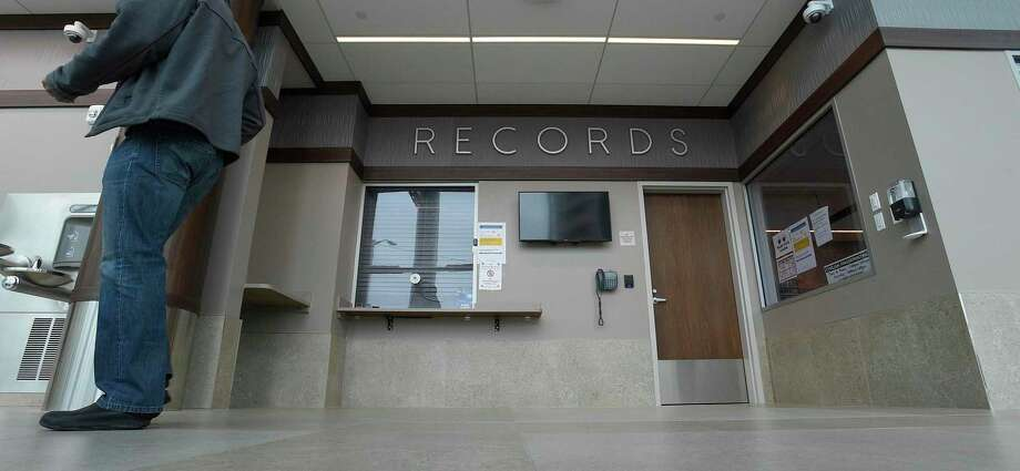 In response to the COVID-19 crisis, the Stamford Police Department has closed the public records service window, shown in a photograph taken on March 19, 2020, at police headquarters in Stamford, Connecticut. Service will continue and be available through an online website only. Photo: Matthew Brown / Hearst Connecticut Media / Stamford Advocate