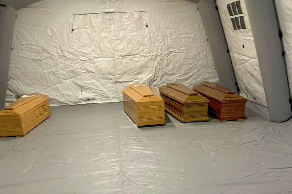 This photo provided by Italian news agency ANSA on March 19, 2020 shows coffins aligned in a tent at the Bergamo hospital, Lombardy on March 18, 2020.