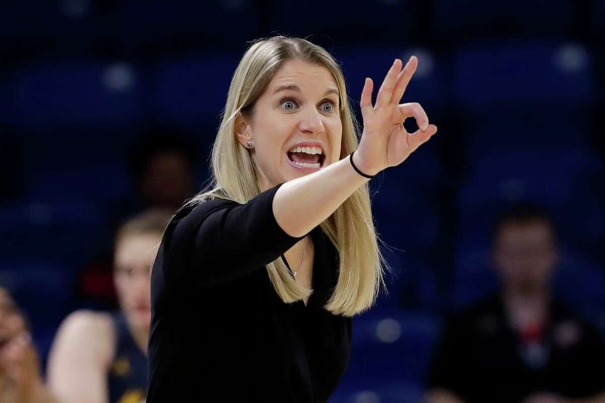 Marquette coach Megan Duffy signals during a March 9 game against DePaul in the Big East Tournament.