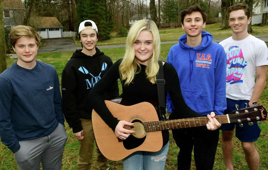 Will Holleman, Ty Chung, Clara Holleman, Will Matar and Jonathan Lorenz otherwise known as the helping guys Thursday, March 19, 2020, in Westport, Conn. The group does good deeds around town and recently sung a song for an elderly resident. Photo: Erik Trautmann / Hearst Connecticut Media / Norwalk Hour