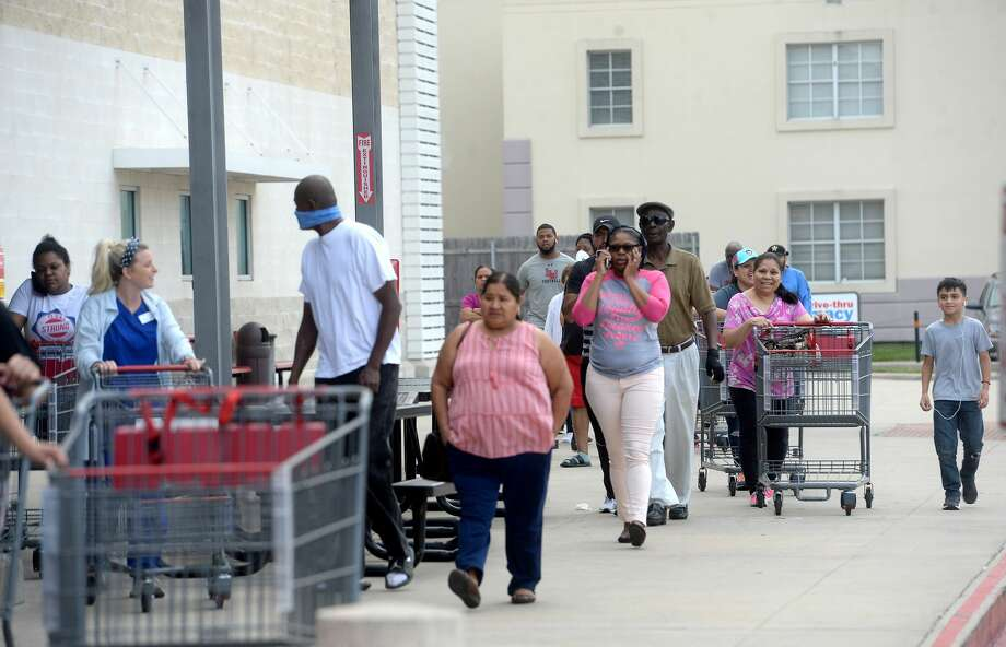 A line of shoppers await admittance outside the H-E-B store on College Street in Beaumont Thursday morning. Long lines gathering for store openings is becoming a morning routine, with shoppers hoping to get restocked items, especially paper products, cleaning supplies and non-perishables, before they quickly fly off the shelves. Photo taken Thursday, March 19, 2020 Kim Brent/The Enterprise Photo: Kim Brent/The Enterprise