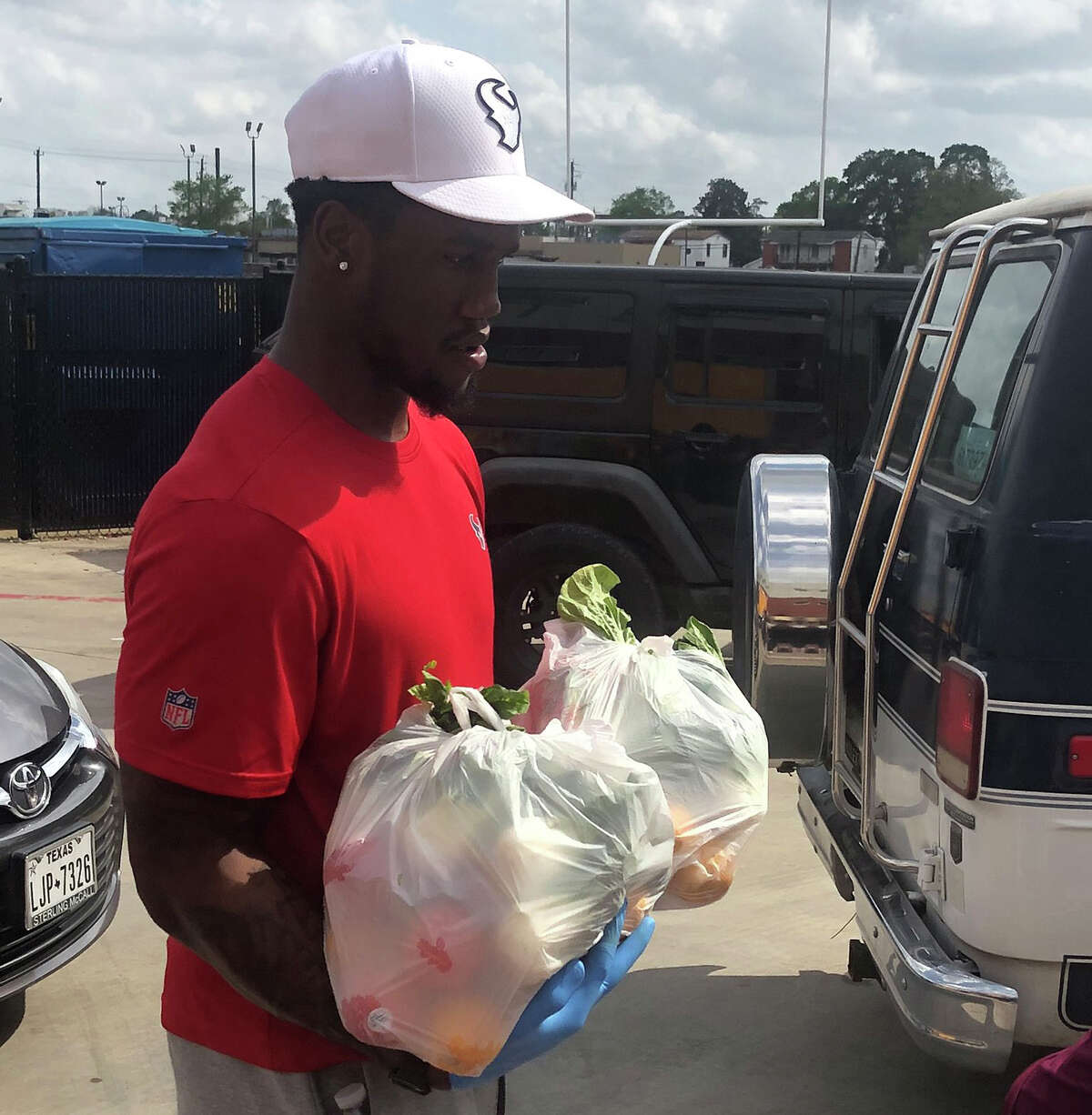 Texans outside linebacker Jacob Martin pitched in at Yates High School in the Third Ward to assist families in need during the coronavirus pandemic.